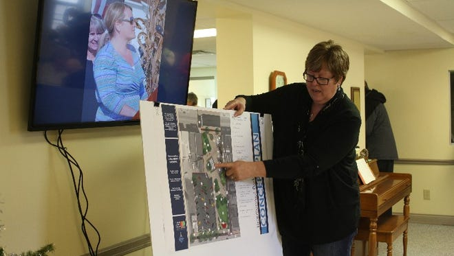 Corydon Town Council President Eva North, points out the features of Bicentennial Park during a dedication ceremony for a Bicentennial Time Capsule to be buried there this spring.