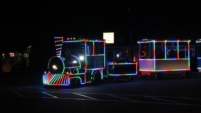 The Charlestown Express Train makes its way around City Square during the Christmas Lights show in Charlestown on Thursday.  Dec. 22, 2016
