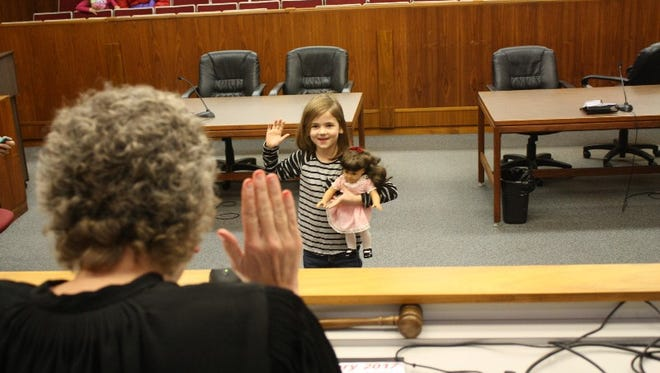Aubrey Isaacs, 5, swears to love her toy, Lovey, during the ninth annual doll adoption event in Judge Vicki Carmichael's Clark County Circuit Court 4 on Saturday.  Jan. 7, 2017