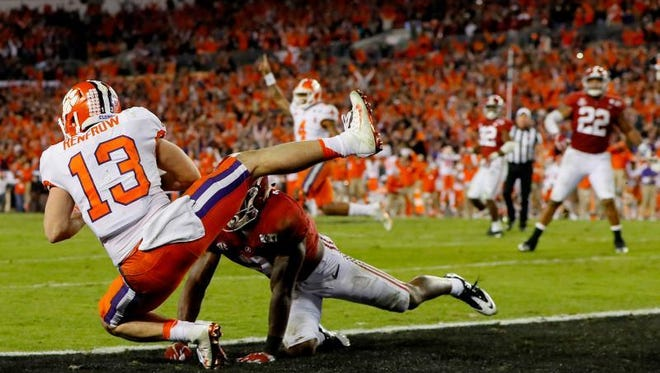 Wide receiver Hunter Renfrow of the Clemson Tigers makes a 2-yard, game-winning touchdown reception against defensive back Tony Brown of the Alabama Crimson Tide during the fourth quarter of the 2017 College Football Playoff National Championship Game