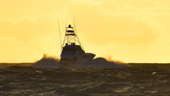 Free Spool led by Capt. Ricky Spikes departs Fort Pierce Inlet Wednesday morning on the opening day of the Pelican Yacht Club's 37th Invitational Billfish Tournament.