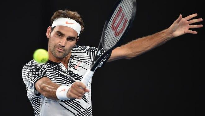 Switzerland's Roger Federer hits a return against Austria's Jurgen Melzer during their men's singles match on day one of the Australian Open in Melbourne.