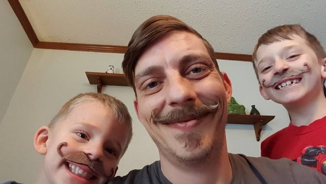 Matt Floyd of Charlotte pictured with his two sons, Alex, 4, and Sebastian, 8, before an October crash. He is still recovering from brain injuries after the three-car crash Oct. 9 between Charlotte and Eaton Rapids. A benefit to help his children is planned for Feb. 4 in Eaton Rapids.
