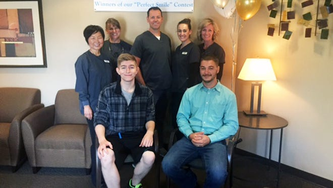 Sean Donohue and Dylan Welty with the Modern Dentistry team.