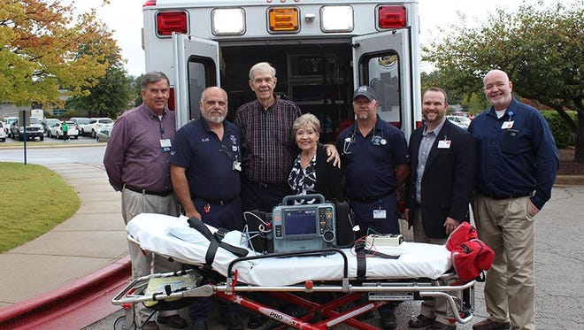 Gerald Cantrell, RN, EMT-P, director of Ambulance Services, from left; Alan Estes, EMT-A; donors Rick and Pam Fairlamb; Roger Tilley, EMT-P, Ambulance Services supervisor; Justin Woods, Major Gifts officer, Baxter Regional Hospital Foundation; and Chris Fry, EMT-P, Ambulance Services supervisor, with the new LIFEPAK 15 that was recently installed in a BRMC ambulance.