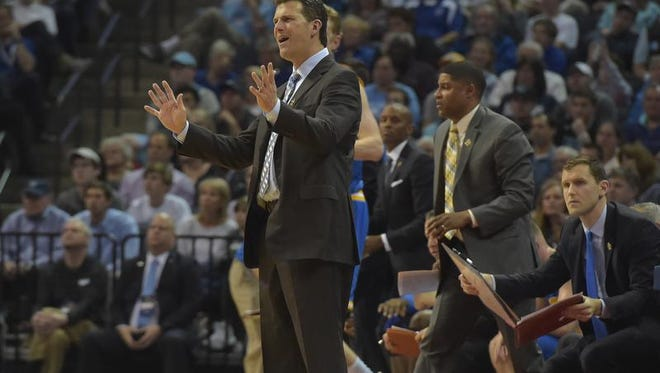 UCLA Bruins head coach Steve Alford reacts  to a play in the first half of Friday night's game against the Kentucky Wildcats during the South Regional at FedExForum.in Memphis, Tennesee. Kentucky won, 86-75.