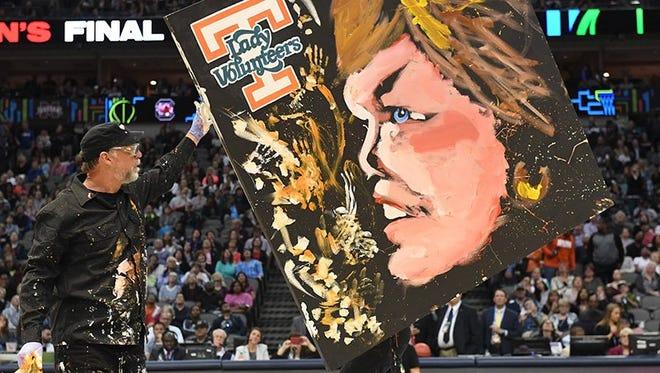 Painter Dan Dunn shows his halftime creation of Pat Summitt on Sunday night in Dallas,