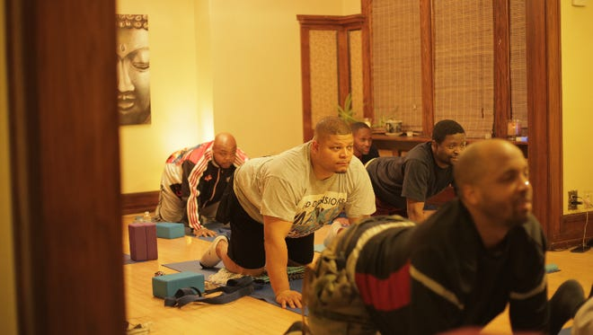 "Members of Walnut Way's Men's Wellness Project take part in an exercise class in this still photo from ""Tha Bridge,"" a documentary about the grassroots group."