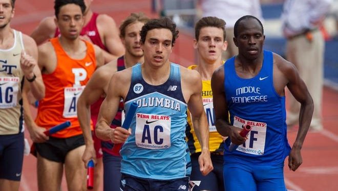 Red Bank Catholic graduate Rob Napolitano (center, wearing AC) competes for Columbia at the Penn Relays.