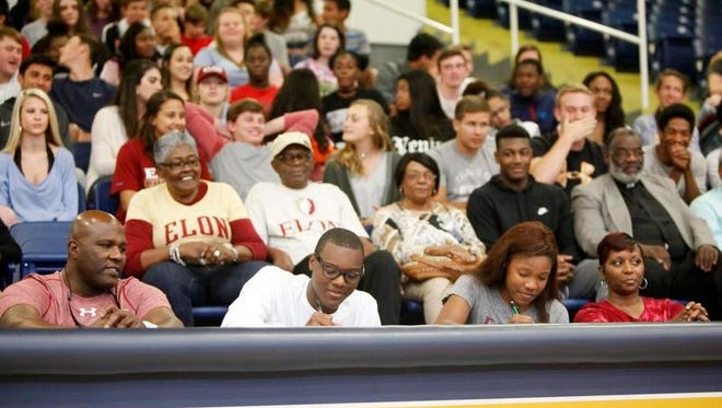 Twins E.J. and Elyse King signed to compete with the track teams at Montreat and Elon, respectively, May 2 at Roberson High School. There to witness were their parents, Ernest King and Makeca Gilliland, and extended family and friends.
