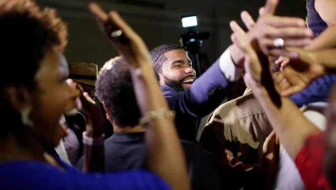Attorney Chokwe Lumumba celebrates with his supporters at the King Edward Hotel Tuesday after winning the Democratic primary for Jackson mayor.