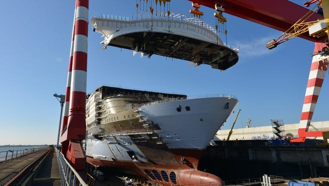 A photo taken in April 2017 shows the bridge area of Royal Caribbean's Symphony of the Seas being lowered into place during the vessel's construction. Symphony will be the world's largest cruise ship when it debuts in April 2018.