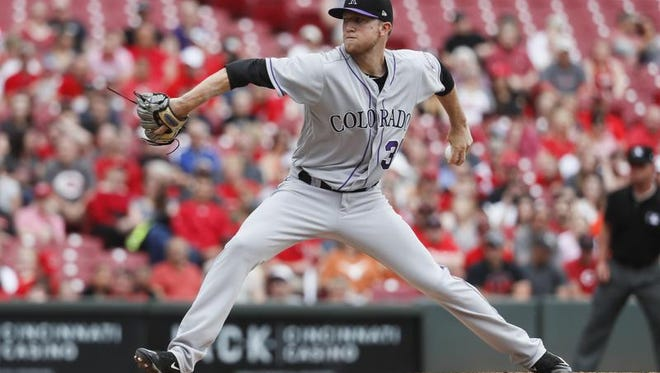 Colorado Rockies starting pitcher Kyle Freeland throws in the first inning of a baseball game against the Cincinnati Reds, Sunday, May 21, 2017, in Cincinnati.