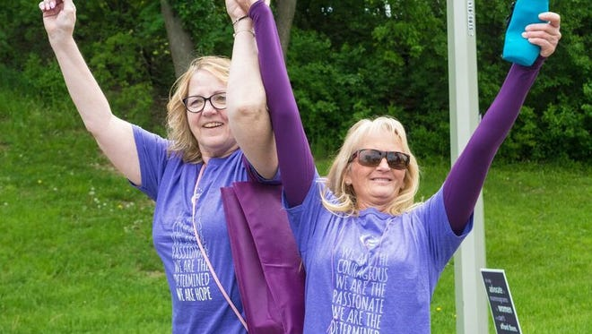 Cancer survivors Peggy DeHaven and Vicki LaMotte celebrating their victory.
