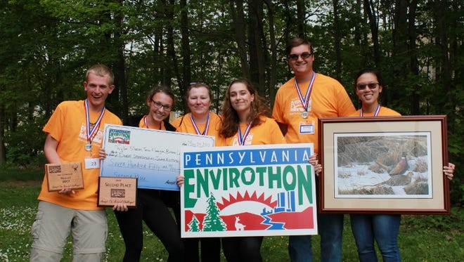 The Palmyra Area High School EnviroVengers (from left) Taylor Slusser, Jamie Kantorczyk, advisor Gina Mason, Tessa Flanagan, Daniel Stonebraker and Briana Long pose with prizes they earned by coming in second at the Pennsylvania Envirothon Championship.