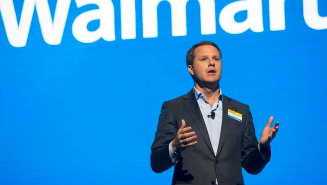 Walmart CEO Doug McMillon speaks during the Walmart shareholders meeting Friday, June 2, 2017, at Bud Walton Arena in Fayetteville, Ark.