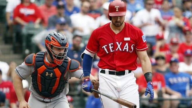 Joey Gallo (13) of the Rangers is tagged out by Houston Astros catcher Evan Gattis (11) after striking out at Globe Life Park in Arlington.