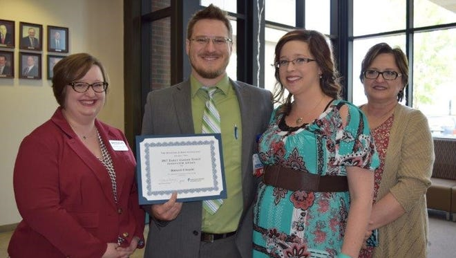 Brady Chase was presented with a $500 cash award by Missouri Nurses Foundation Board Member Karen Johnson and Missouri Nurses Association State Director Heidi N. Lucas.