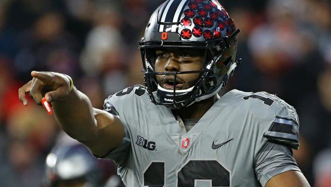 Buckeyes quarterback J.T. Barrett (16) signals to his team prior to a play against the Penn State Nittany Lions.