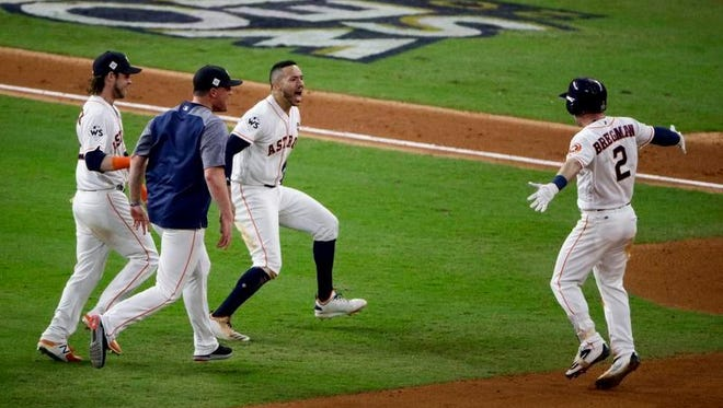 The Houston Astros celebrates after Alex Bregman's (2) game winning single during Game 5 of baseball's World Series against the Los Angeles Dodgers Monday.