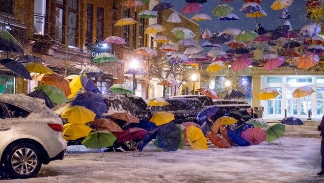 Umbrellas tumble down onto cars on Nov. 1.