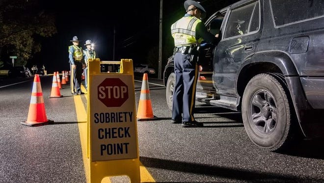 Delaware State Police stop vehicles at a DUI checkpoint in Seaford on Nov. 4.