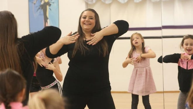 Dana Seeman Baker is reflected in a mirror as she leads a Nov. 15 dance class. Seeman Baker is the new owner of The Dance Factory in Indianola after being a student at the studio as a child.