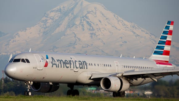 An American Airlines Airbus A321 lands at Seattle-Tacoma