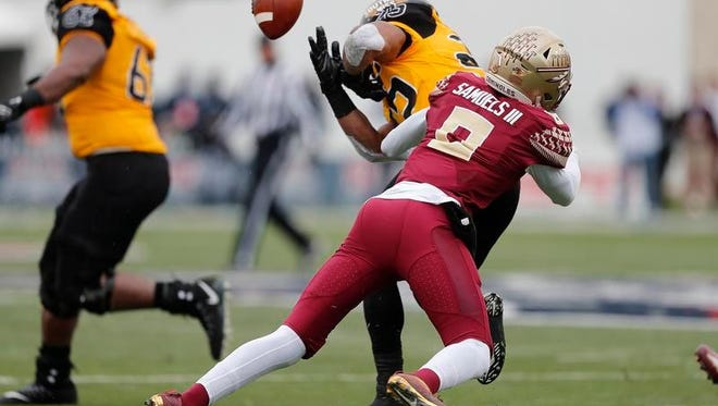 Florida State defensive back Stanford Samuels III (8) forces a fumble by Southern Mississippi running back Ito Smith (25), setting up a Florida State touchdown, in the first half of the Independence Bowl NCAA college football game in Shreveport, La., Wednesday, Dec. 27, 2017.