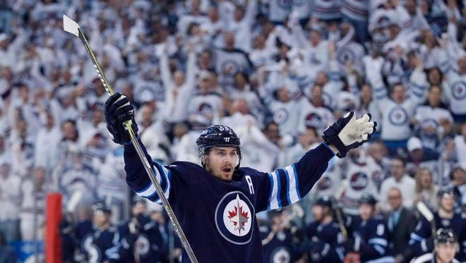 Winnipeg Jets' Mark Scheifele (55) celebrates his goal against the Minnesota Wild during the second period of Game 1 in an NHL hockey first-round playoff series Wednesday, April 11, 2018, in Winnipeg, Manitoba