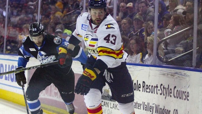 The Colorado Eagles' Matt Register chases the puck during Friday night's 6-0 loss to the Wichita Thunder in the first round of the Kelly Cup playoffs at the Budweiser Events Center.
