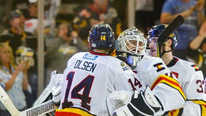 Colorado's Ryan Olsen, who scored the game-winner in Wednesday's Game 7 win over Fort Wayne, is congratulated by goalie Joe Cannata.