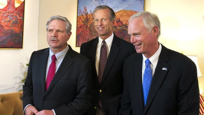 U.S. Sen. John Hoeven, R-N.D., left, Sen. John Thune, R-S.D., center, and Sen. Jerry Moran, R-Kan., chairman of the Subcommittee on Consumer Protection, Product Safety, Insurance, and Data Security, speak to the Associated Press in the U.S. Embassy in Moscow, Russia, Wednesday, July 4, 2018. A U.S. senator who is part of a congressional delegation visiting Russia says Moscow could help improve ties by not meddling in the midterm U.S. election in November.