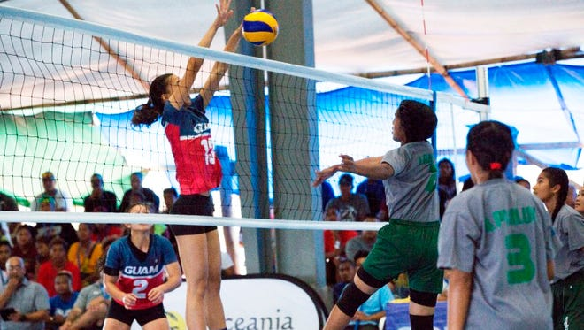 Guam's Lori Okada shuts down a spike by a player from Chuuk during their game July 20 at the 9th Micronesian Games in Yap.