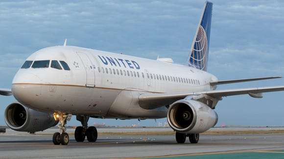 A United Airlines Airbus A319 taxies to a gate after