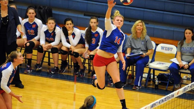 West Henderson's Taylor Houck goes up to make a kill in Tuesday's 3-A Western Regional championship match.