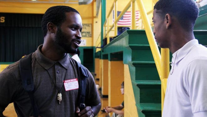 Alfonso Franklin, a project manager for the Mississippi Center for Justice, talks to a young man in his Youth in Transition program. Franklin's program aims to keep youth out of jail by keeping them in school and providing jobs and mentors.