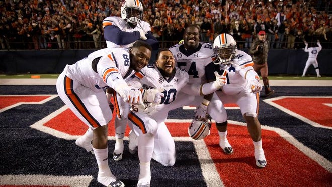 Auburn players gather for a photo after a 35-31 win Saturday at Ole Miss.