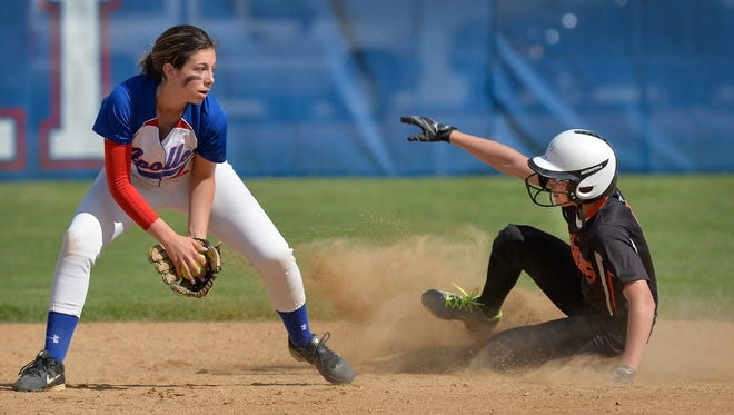St. Cloud Tech's Reagan Lyle (4, right) slides safely into second base before St. Cloud Apollo's Kalli Mathiasen (2) can get there in the second inning Monday, May 16, 2016, at Apollo High School. Tech went on to win 8-0.