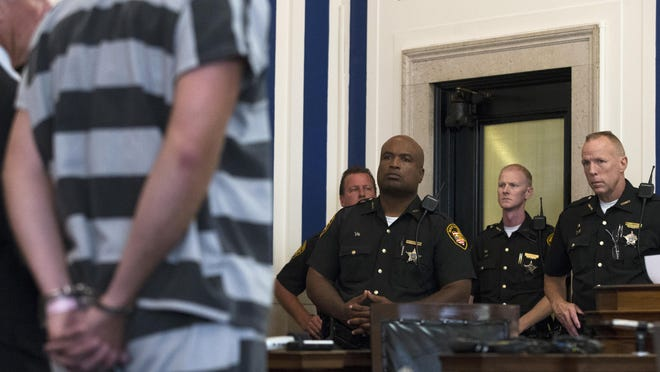Court officers look on as former University of Cincinnati police officer Ray Tensing, left, appears at Hamilton County Courthouse for his arraignment in the shooting death of motorist Samuel DuBose, Thursday, July 30, 2015, in Cincinnati. Tensing, who was indicted and fired from his job on Wednesday, shot and killed Dubose on July 19 after stopping him over a missing license plate. Tensing pleaded not guilty Thursday to charges of murder and involuntary manslaughter. (AP Photo/John Minchillo)