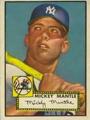 Right: The 1952 Topps Mickey Mantle rookie card is