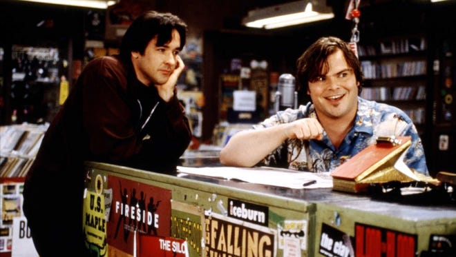 """John Cusack and Jack Black (in """"High Fidelity"""") are here to wish you Happy Record Store Day."""