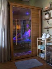 Kate Strakosch, owner of Sunshine Kate's and Melissa Grossman, owner of Shore Massage, two wellness businesses that share a space in Ocean Twp. Liz Petersen, Pt. Pleasant, in the new sauna —September 12, 2016-Ocean, NJ.-Staff photographer/Bob Bielk/Asbury Park Press