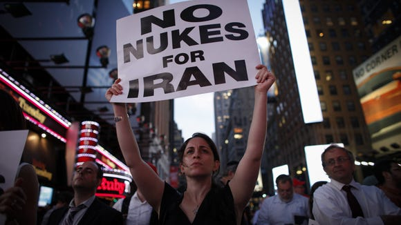 A woman holds a poster as she takes part in a July 22 rally in New York.