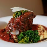 The Constatine from Cena Italian Trattoria features slow braised short rib in a sauce topped with horseradish gremolata, parmesan region with aged balsamic on polenta and brocolini.  $17. Aug. 25, 2015