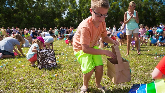 Children race to gather more than 25,000 Easter eggs during the 21st annual Royal Scoop Easter Egg Hunt at New Life Church in 2015, in Bonita Springs.