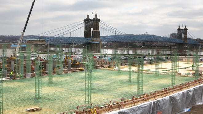 Work continues on apartments at the Banks Thursday, December 3, 2015. The team overseeing development of Cincinnati's riverfront wants $37 million from taxpayers for parking and foundation work that could pave the way for new apartments, a music pavilion and maybe a new University of Cincinnati law school.
