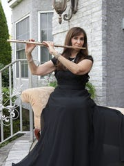Michele Spadaro, Toms River, is a flutist who owns