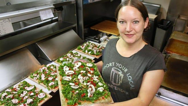 Hannah Roland makes vegetarian and vegan pizzas.