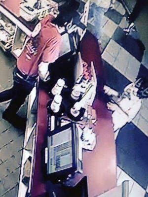 Travis Sattler, shown March 18, 2015, on surveillance video helping the little boy who didn't have enough money to buy a mini mint Oreo custard.
